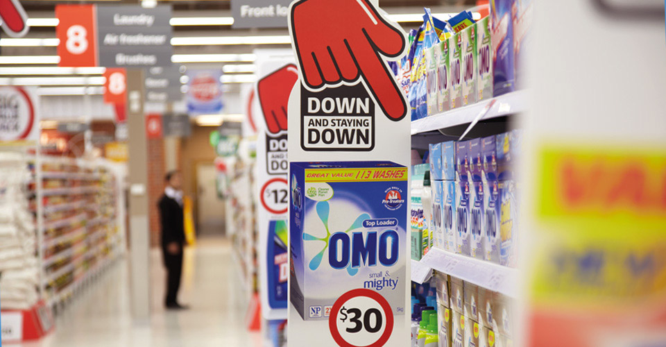 Coles Down Down red hand in laundry product aisle