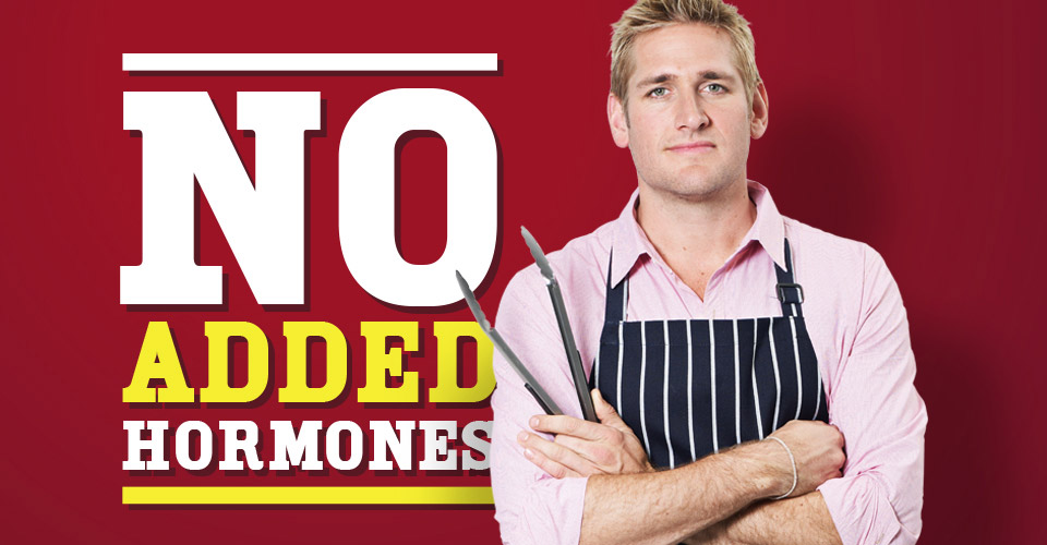 Curtis Stone holding tongs with message background