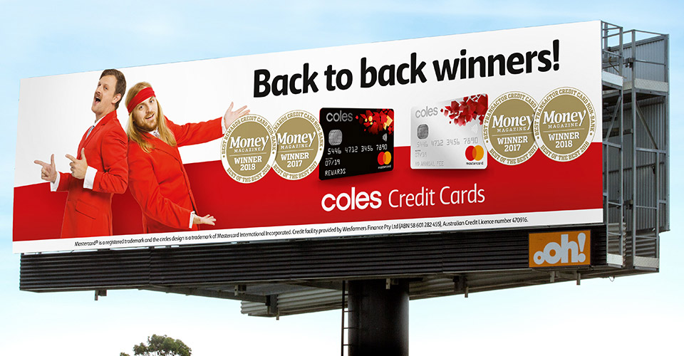 Coles credit cards billboard with two men in red suits
